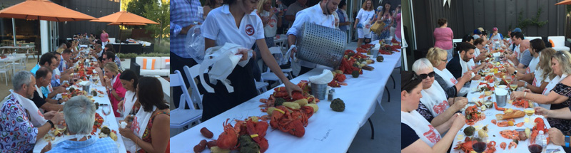 People at at able, lobster decorations, people eating lobster