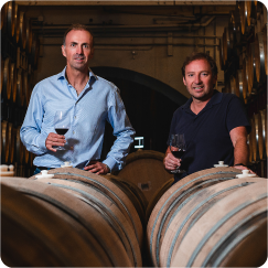 Rene and Winemaker in caves